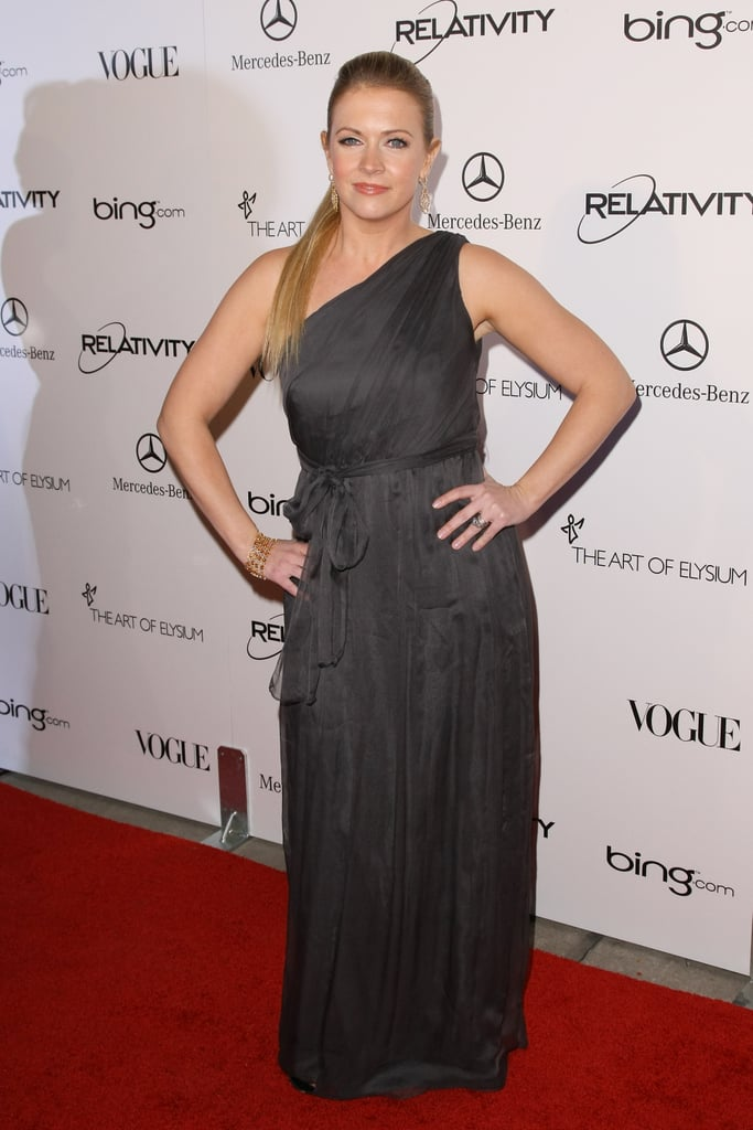 Melissa Joan Hart in a charcoal one-shoulder gown.