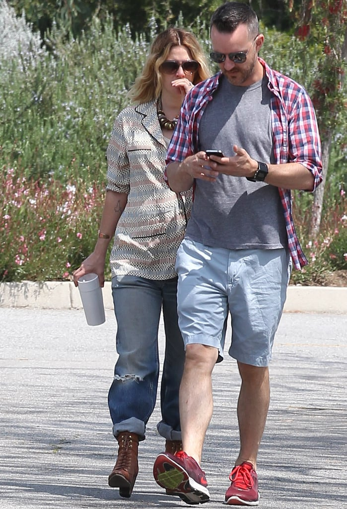 Drew Barrymore wore a loose jacket.