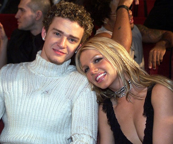 Britney Spears and Justin Timberlake cuddled close in their seats during the show in 2000.