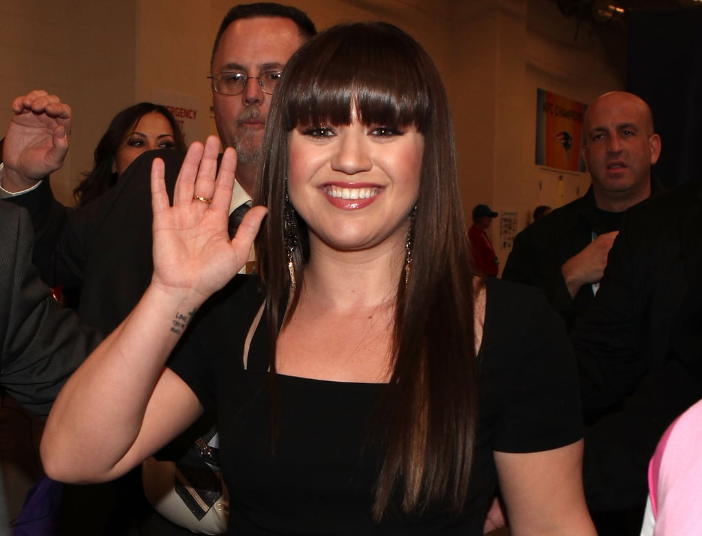 Kelly Clarkson smiled after performing the national anthem in 2012.