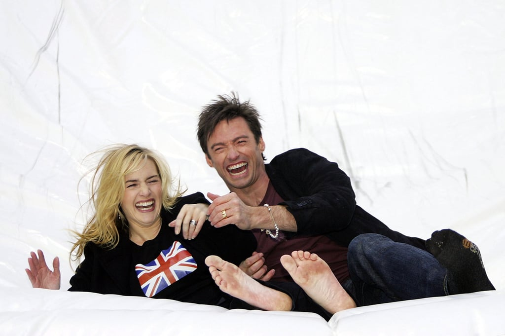 Kate Winslet and Hugh Jackman were caught clowning around during an October 2006 press event in NYC.