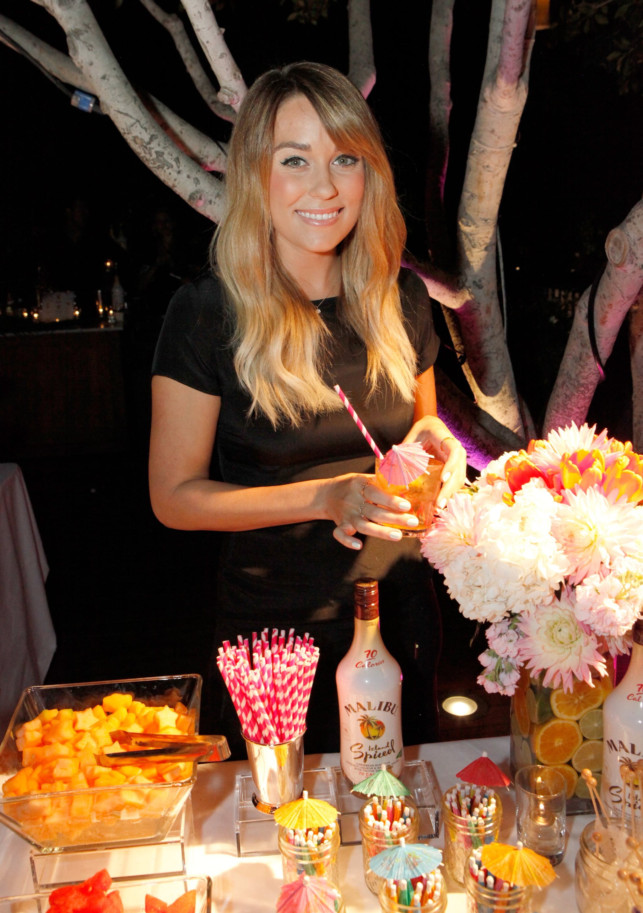 Lauren Conrad showed off her drink-styling skills at the party.