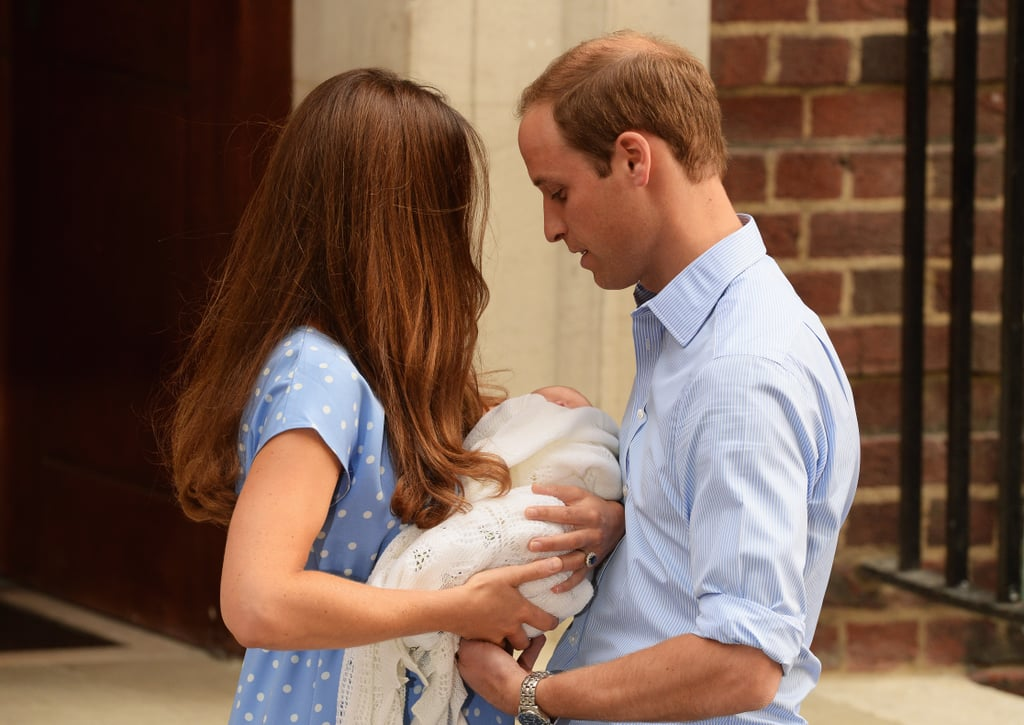 Kate transferred one-day-old Prince George into his father's arms.