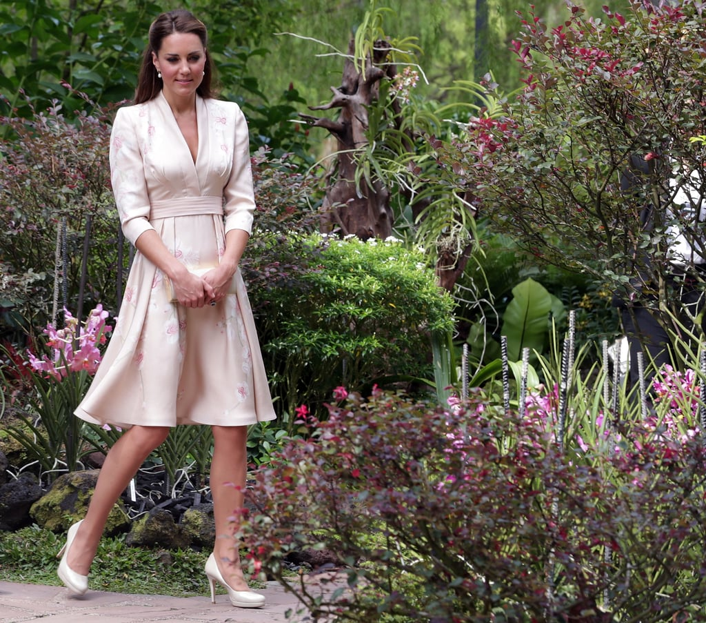 The Duchess of Cambridge complemented the Singapore Botanic Gardens' scenery with a pretty hand-painted orchid dress by Jenny Packham.