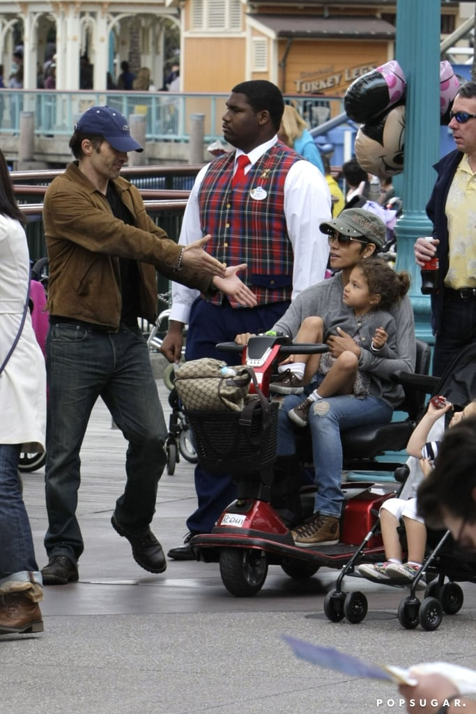 Olivier Martinez offered a helping hand to an injured Halle Berry and her daughter, Nahla Aubry, during a Disney visit in January 2012.