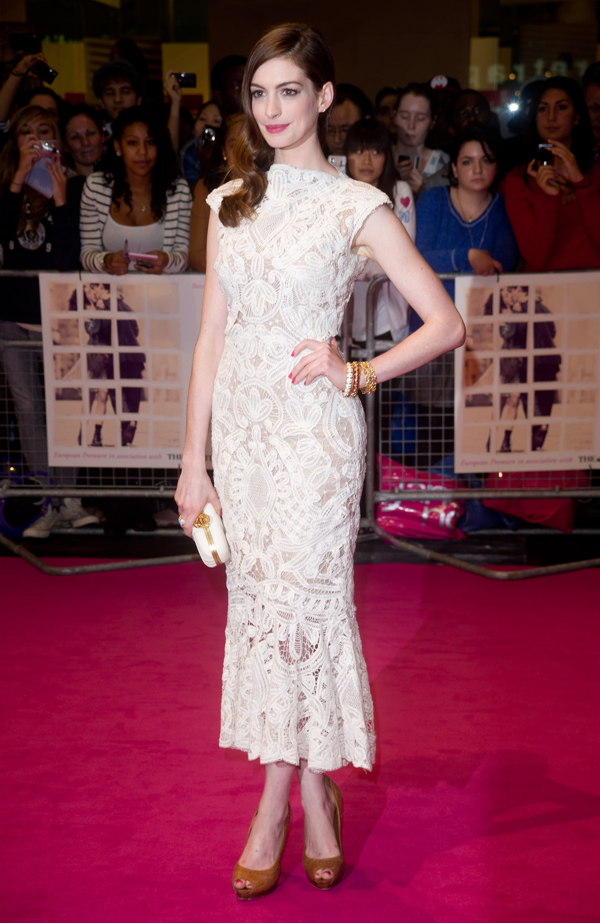 Anne Hathaway wore a high-neck dress and showed a flash of ankle.