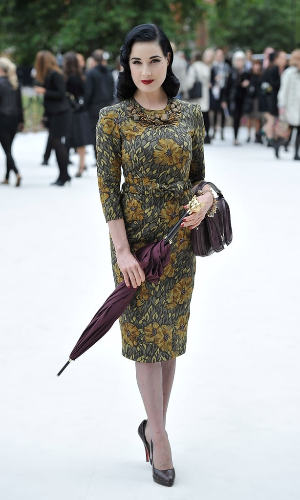 Dita Von Teese stayed totally sophisticated in a printed sheath dress and pumps at Burberry.
