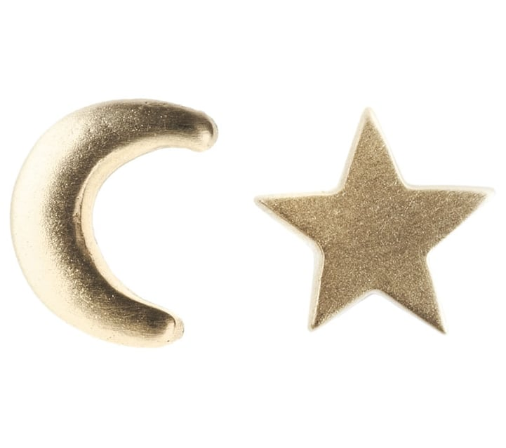 """I love the rebelliousness of mismatched earrings, but they should feel sophisticated, not punkish. These pure gold studs, made by New York-based designer Giovanna Galeotafiore, are a chic, grownup take that still maintain a sense of fun. This style representing the moon and stars sums up how important my girlfriends are to me!"" — Noria Morales, editor  Social Anarchy Moon and Stars Studs ($220)"