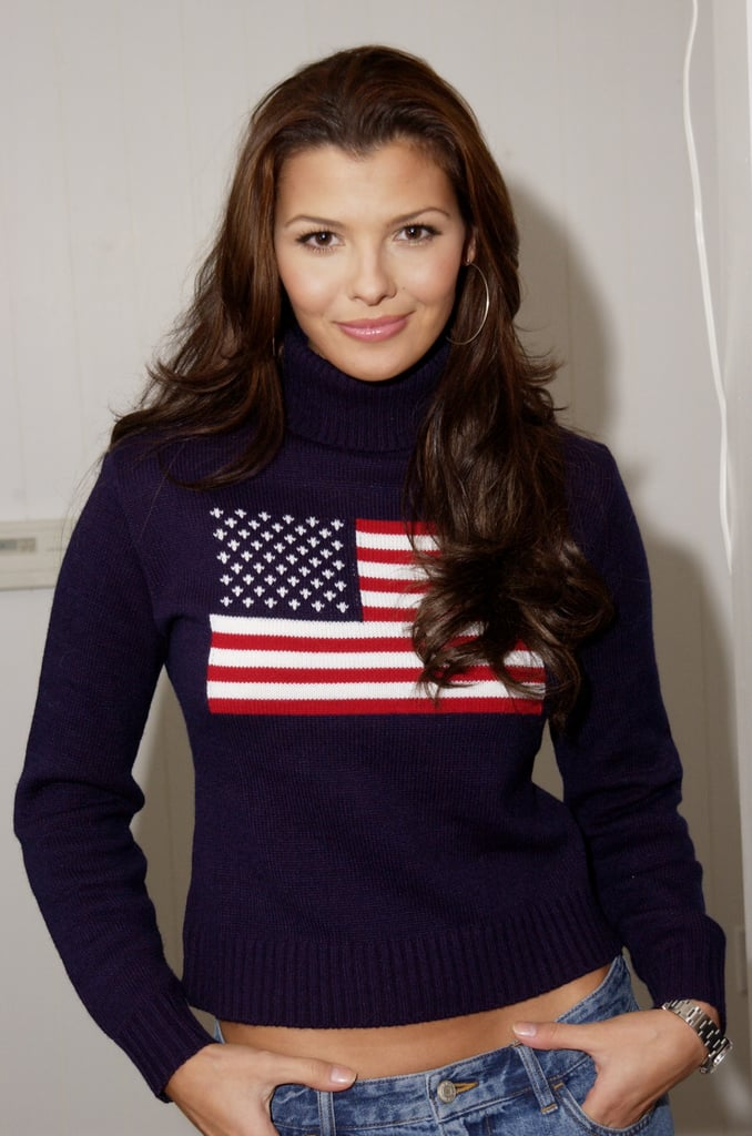 Ali Landry rocked a flag sweater while posing in LA in December 2001.