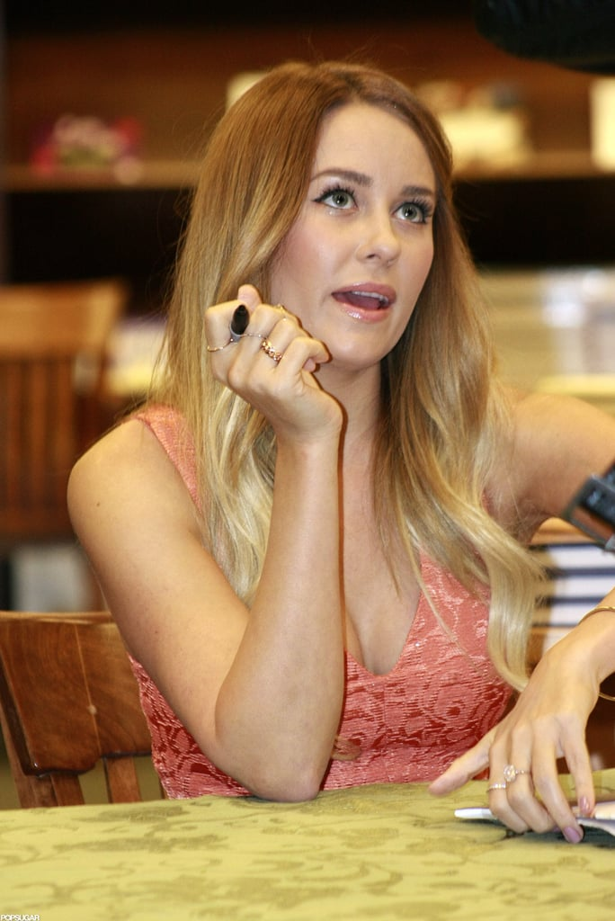 Lauren Conrad chatted with a fan while signing a book.