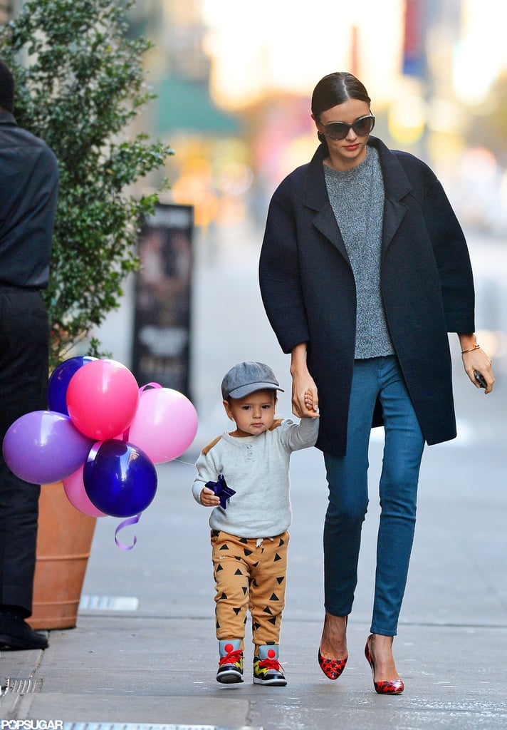 Flynn Bloom carried balloons with him for a stroll with mom Miranda Kerr.