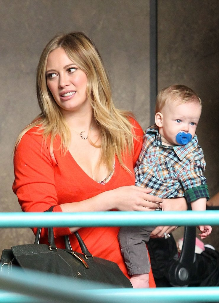 Hilary Duff wore a red sweater to a class with Luca Comrie.