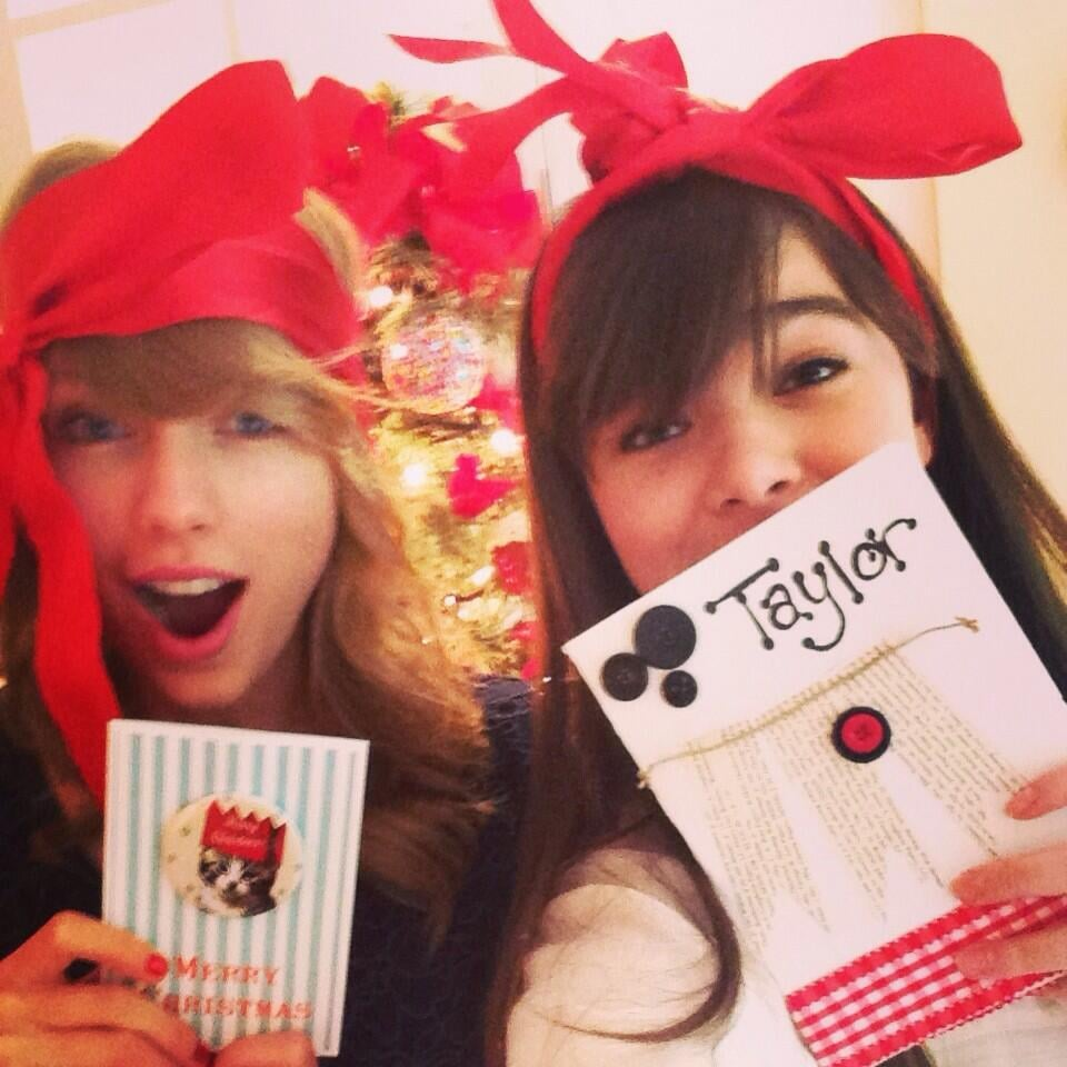 Best friends Taylor Swift and Hailee Steinfeld celebrated Christmas early together, exchanging gifts and wearing bows.  Source: Twitter user haileesteinfeld