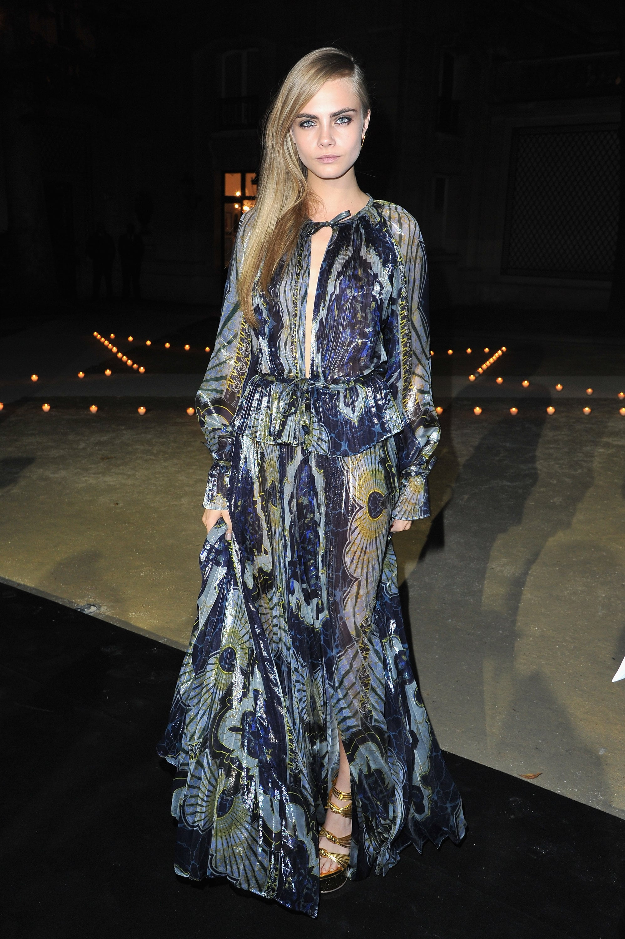 Cara Delevingne wore a floor-length printed and semisheer gown to the Carine Roitfeld for MAC party in Paris.