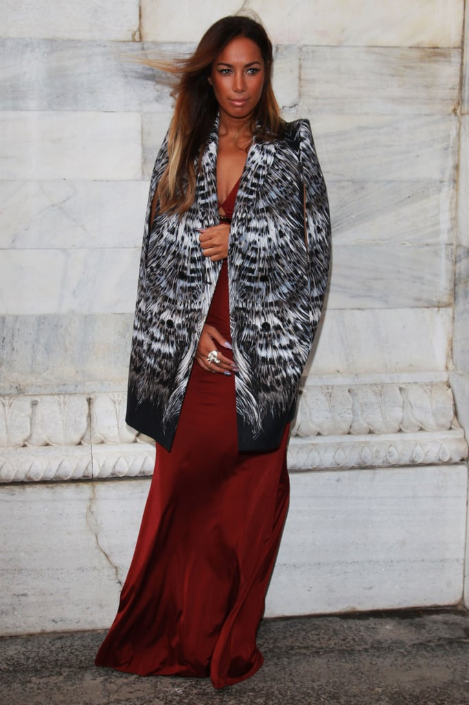 Leona Lewis topped her scarlet gown with a contrasting black and white print coat outside Roberto Cavalli's show.