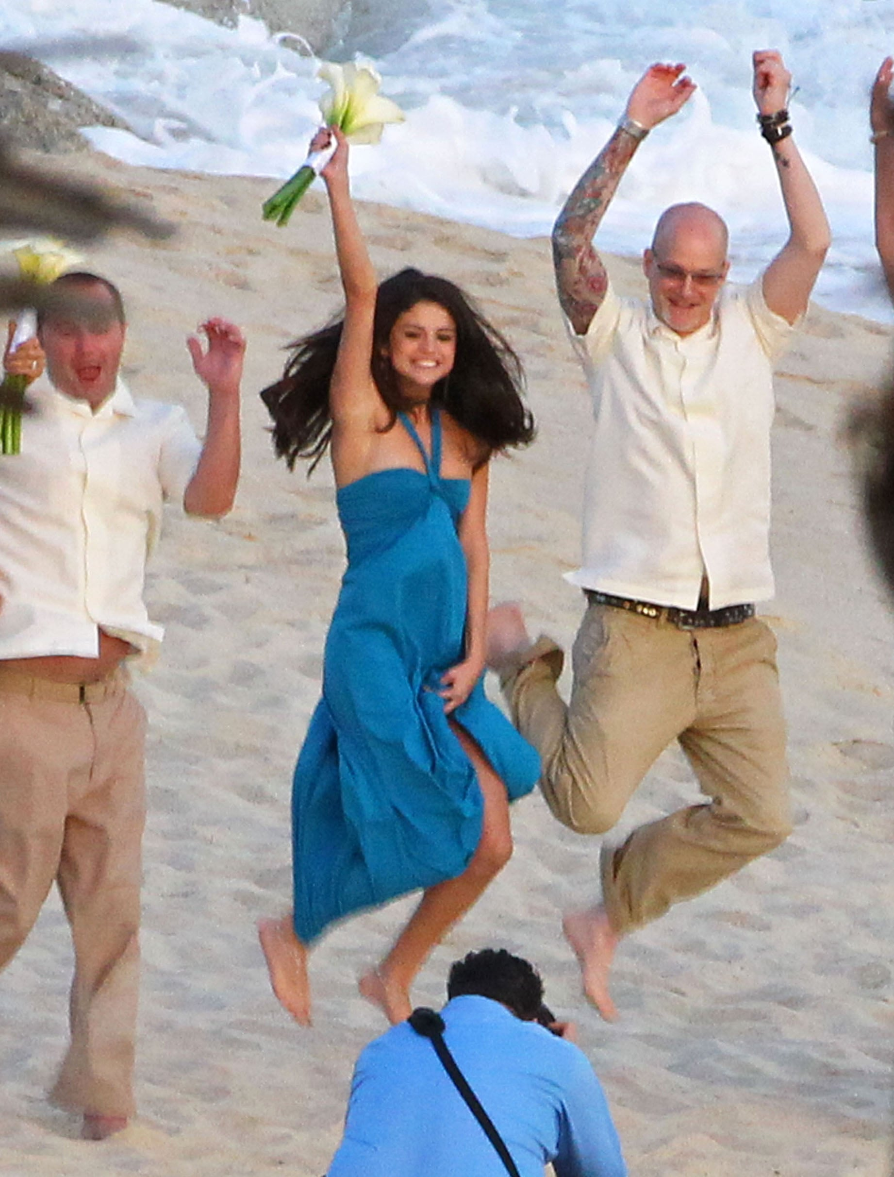 Selena Gomez posed for a photographer at her friend's Mexico beach nuptials in December 2011.