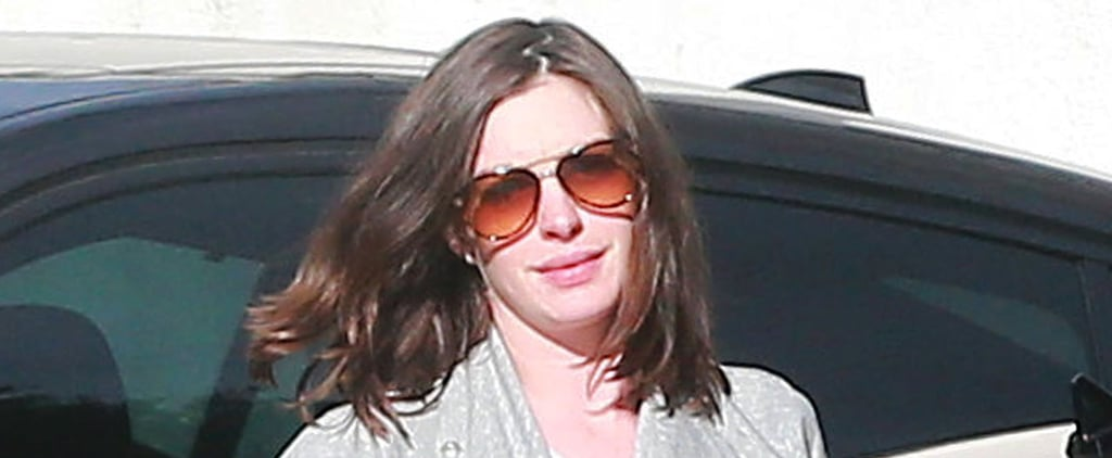 Anne Hathaway Gives Us a Peek at Her Blossoming Baby Bump During a Trip to the Gym
