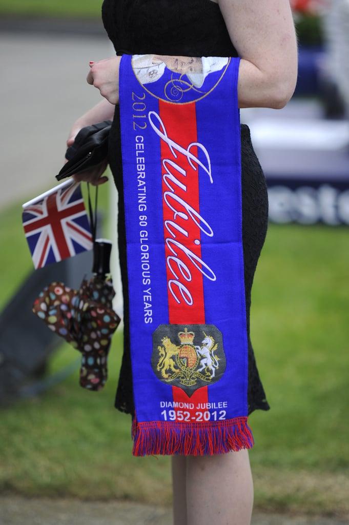A racegoer held memorabilia at the derby.
