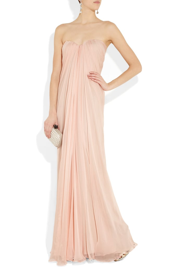 """While the sweetheart neckline is totally traditional and demure, I love the unexpected feel of a light peachy pink hue instead of a classic white wedding gown."" — Marisa Tom, associate editor Alexander McQueen Silk-Chiffon Bustier Gown ($2,307)"