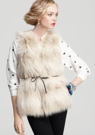Experiment with textures and pair this Winter white vest with a cable-knit sweater and leather leggings for cozy dimensional look.  Juicy Couture Polar Faux Fur Vest ($278)