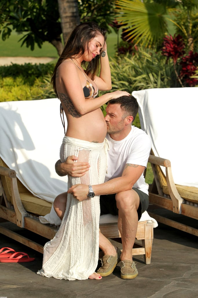 Brian Austin Green kissed Megan Fox's pregnant stomach.
