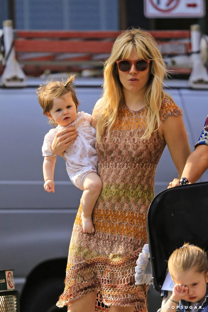 Sienna Miller wore a Missoni dress as she carried Marlowe Sturridge during a playdate in NYC.