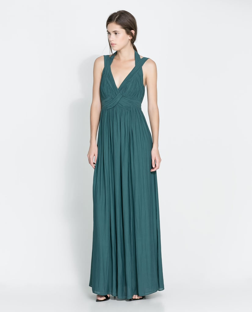 A gorgeous serene hue and Grecian-style gathering make this