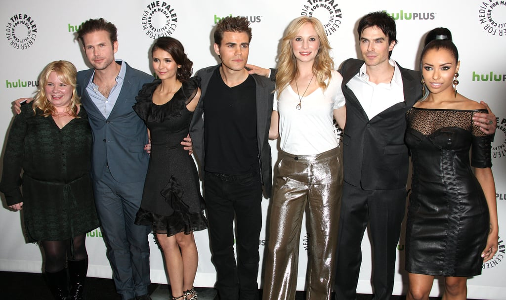 The cast stopped to snap a few shots together.