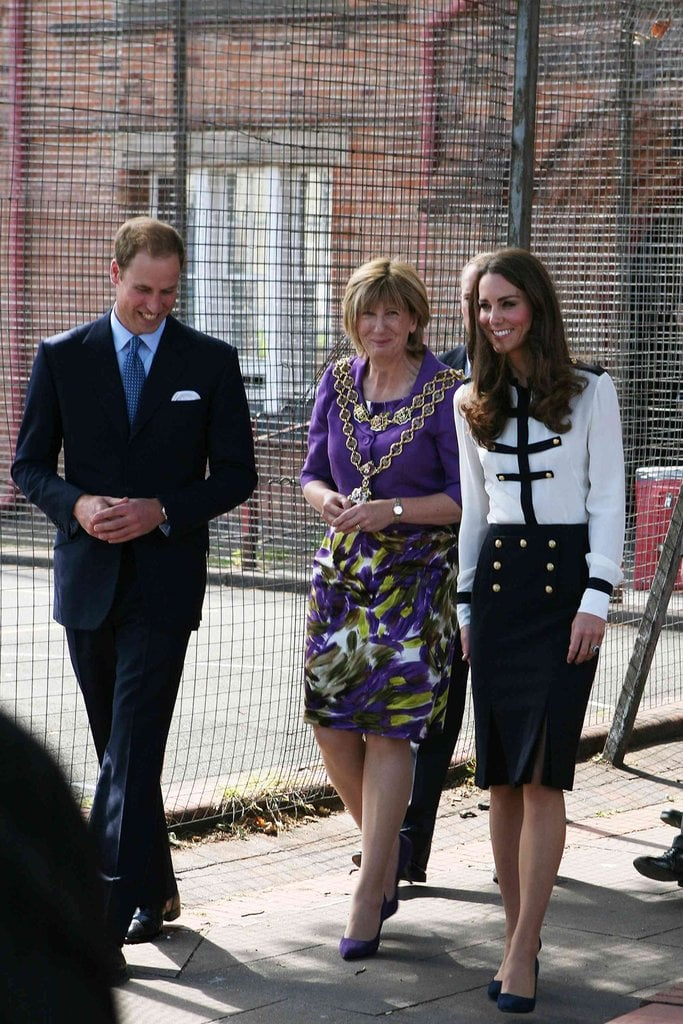 Kate looked military-inspired chic in an Alexander McQueen blouse and skirt set.