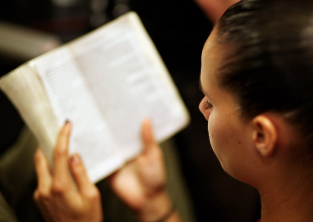 A model read a book ahead of her show during L'Oreal Melbourne Fashion Festival in 2008.
