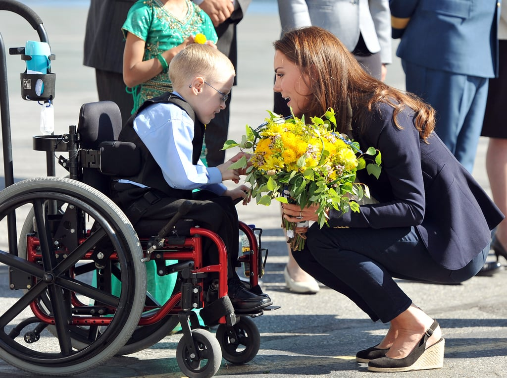Kate Middleton bent down to talk to a young boy.