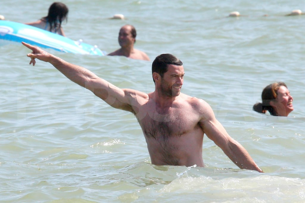Hugh Jackman shirtless showing muscles.