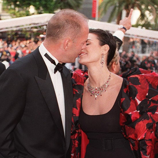 Bruce Willis and Demi Moore shared a sweet moment on the red carpet in 1997.