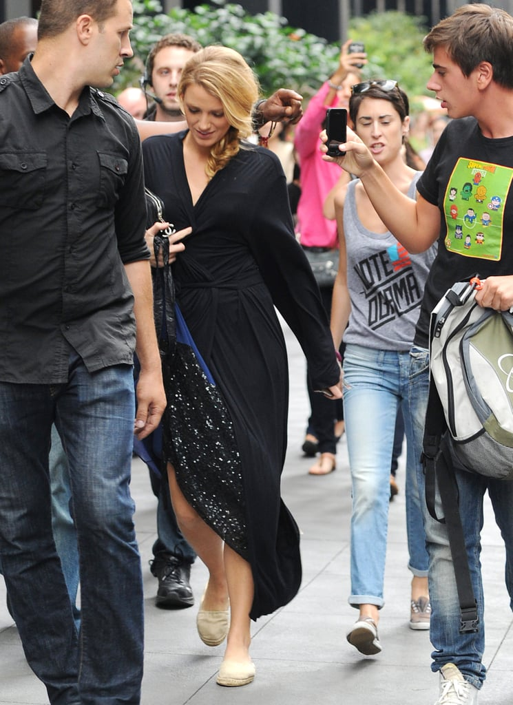 Blake Lively walked onto set covered in a black robe.
