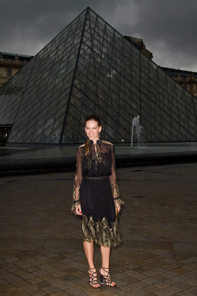 Hilary Swank posed in front of the Louvre for the Salvatore Ferragamo  show in Paris.