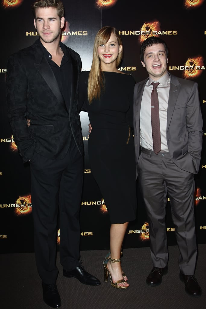 Liam Hemsworth, Jennifer Lawrence, and Josh Hutcherson at The Hunger Games premiere in Paris.