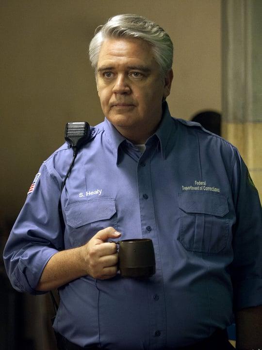 Michael Harney as Sam Healy