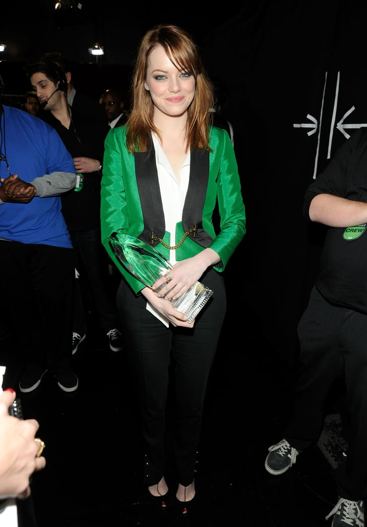 Emma Stone couldn't stop smiling backstage at the 2012 People's Choice Awards.