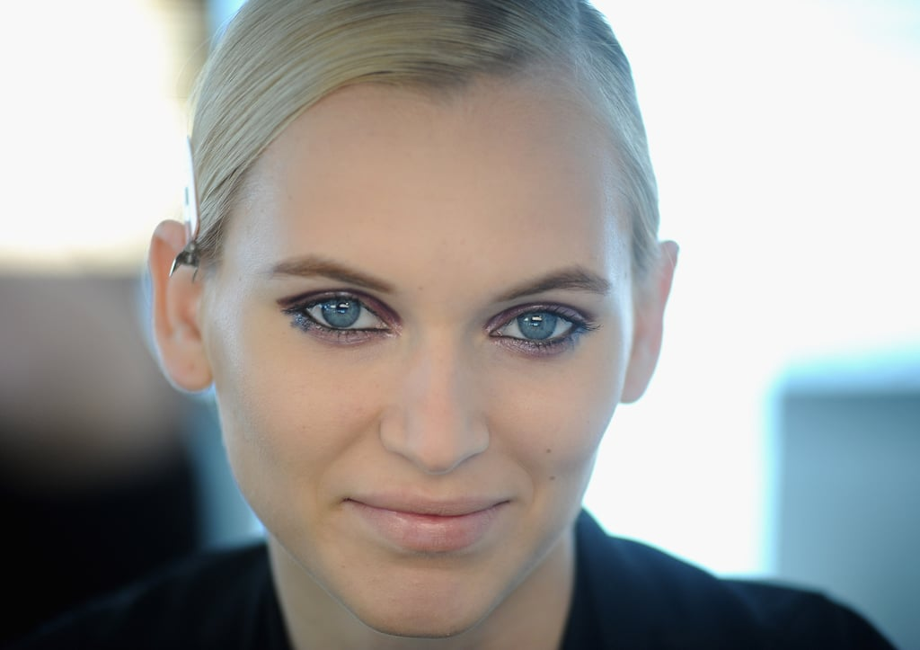 Pecheux used Kohl Power Eye Pencil in Feline, a deep black, on the bottom waterline, and to draw three faux lashes in the corners. The cheeks were left bare and the lips a matte nude. Gorgeous, no?