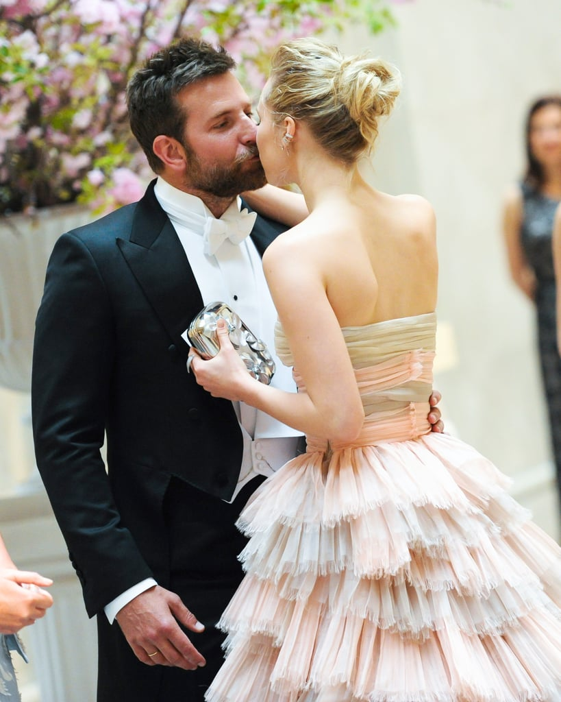 Bradley Cooper and Suki Waterhouse, who called it quits in March, stopped for a kiss on their way into the party. The pair recently sparked reconciliation rumors after they were spotted getting cozy at Coachella in April.