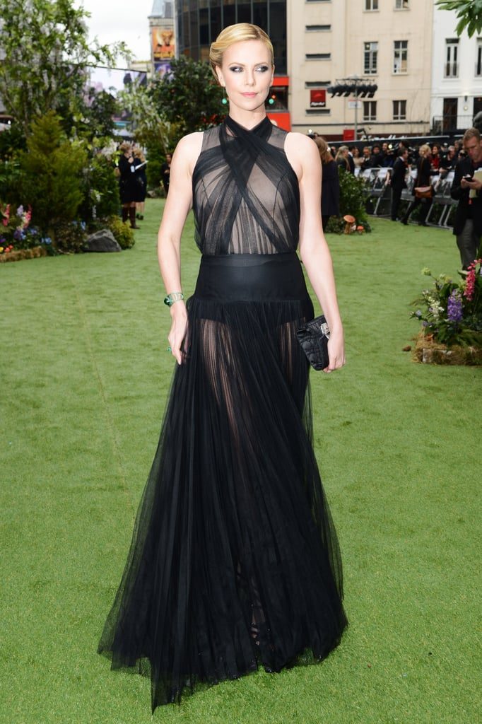 Charlize opted for black hot pants for coverage under her gown.