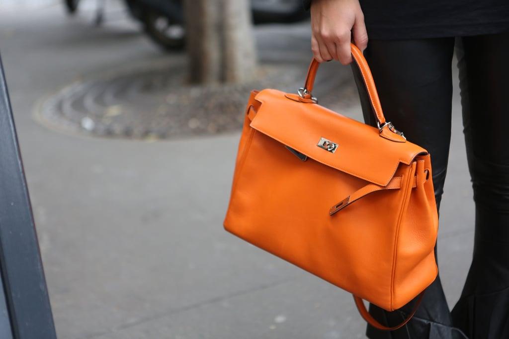 A classic satchel got a makeover in a shot of electric orange.