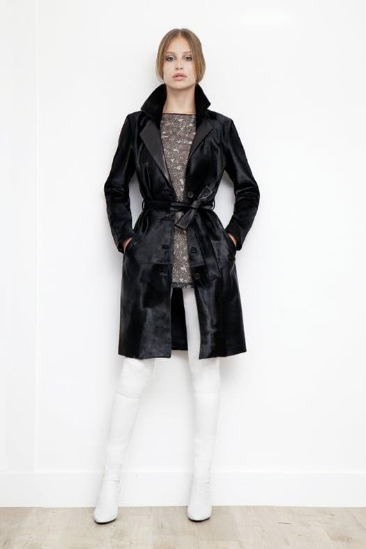 Long Sleeve Lace Window Print Silk Blouse in Black ($450), Calf Hair Trench Coat in Black ($3,995), Sweet Revenge Stretch Nappa Legging Boot in Cream ($2,395) Photo courtesy of Tamara Mellon