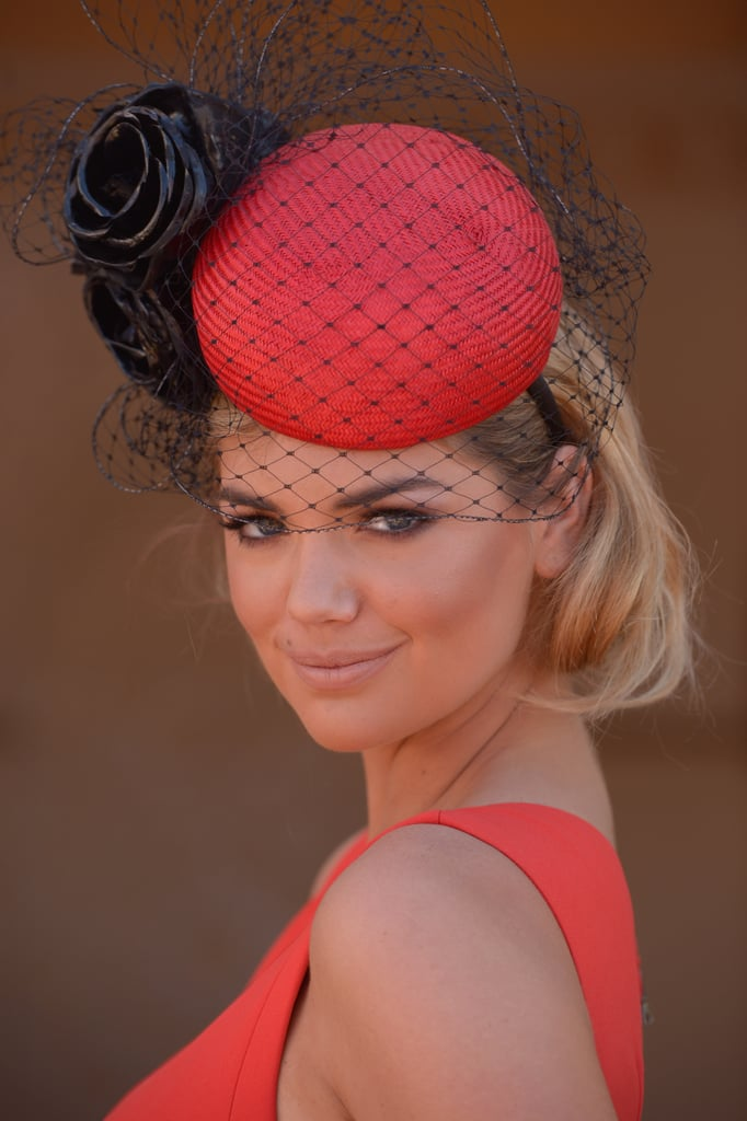 Kate Upton obviously wanted her scarlet hat to do the talking at the Melbourne Cup, so she twisted her long hair up into a fake bob to keep it looking chic and simple. This is a great look for a wedding or a day at the races.