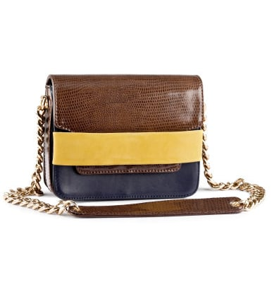 This little crossbody bag packs just enough of a punch with its colorblocking, but we love it even more for its functionality.  H&M Leather Crossbody Bag ($60, available in stores)