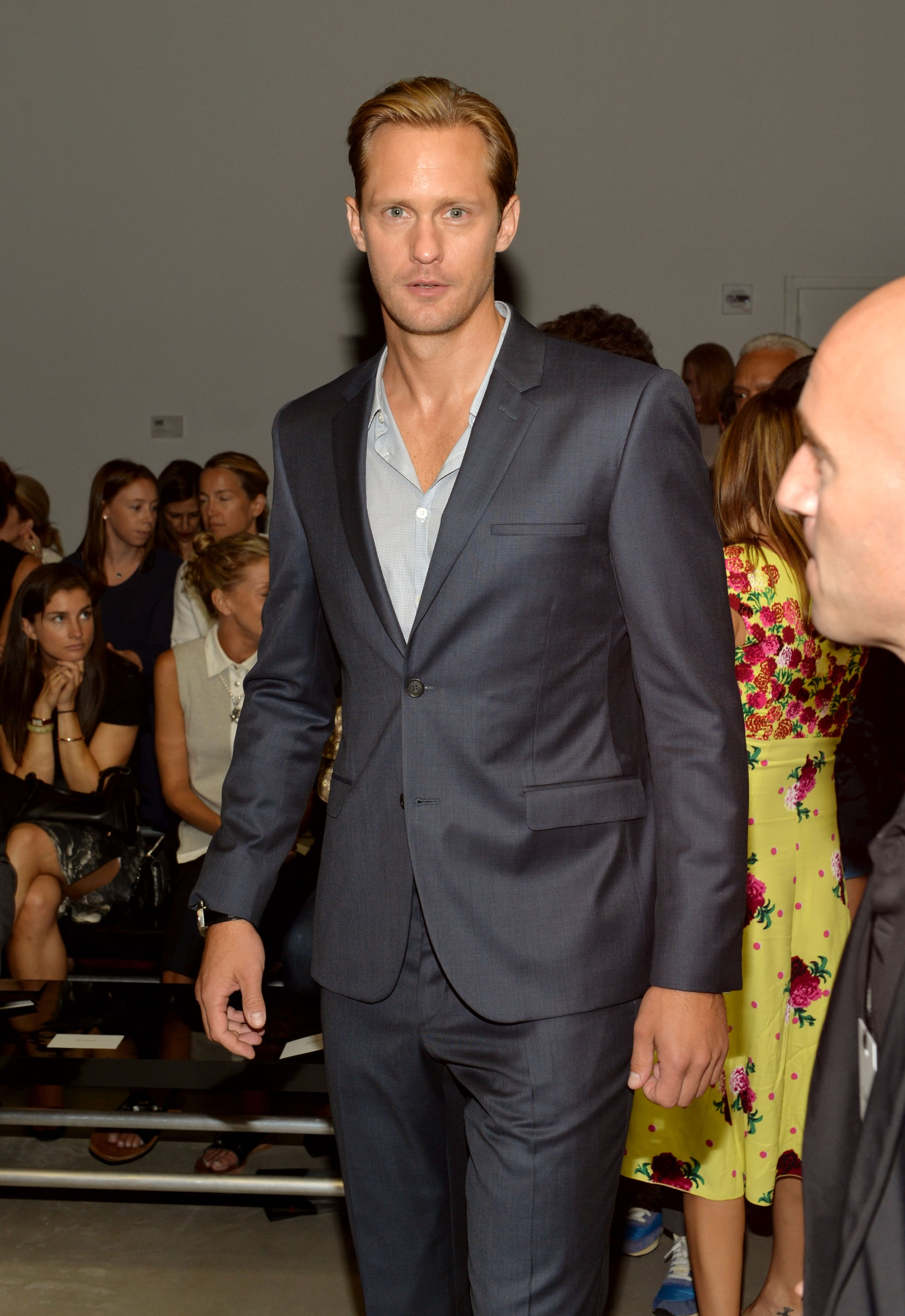 Alexander Skarsgard looked handsome in a blue suit at the Calvin Klein fashion show on Wednesday.