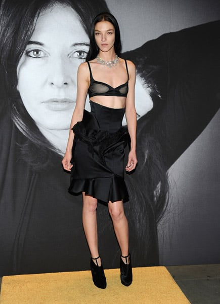 Favorite Givenchy model Mariacarla Boscono was the most daring guest of all in her bralette and ruffle skirt.