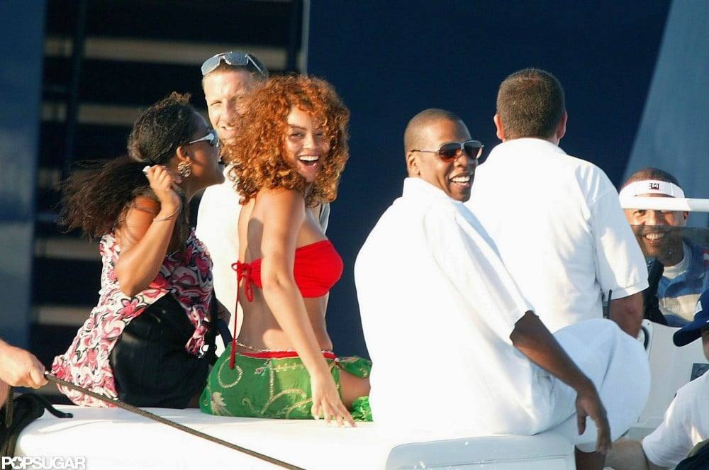 Beyoncé wore a red bikini top during a boat ride with Jay Z while on their August 2003 Saint-Tropez vacation.
