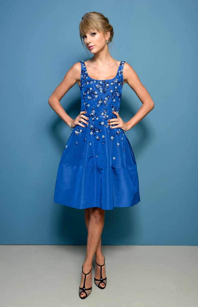 Taylor Swift posed pretty in a blue embellished Oscar de la Renta gown for the One Chance photoshoot in Toronto.