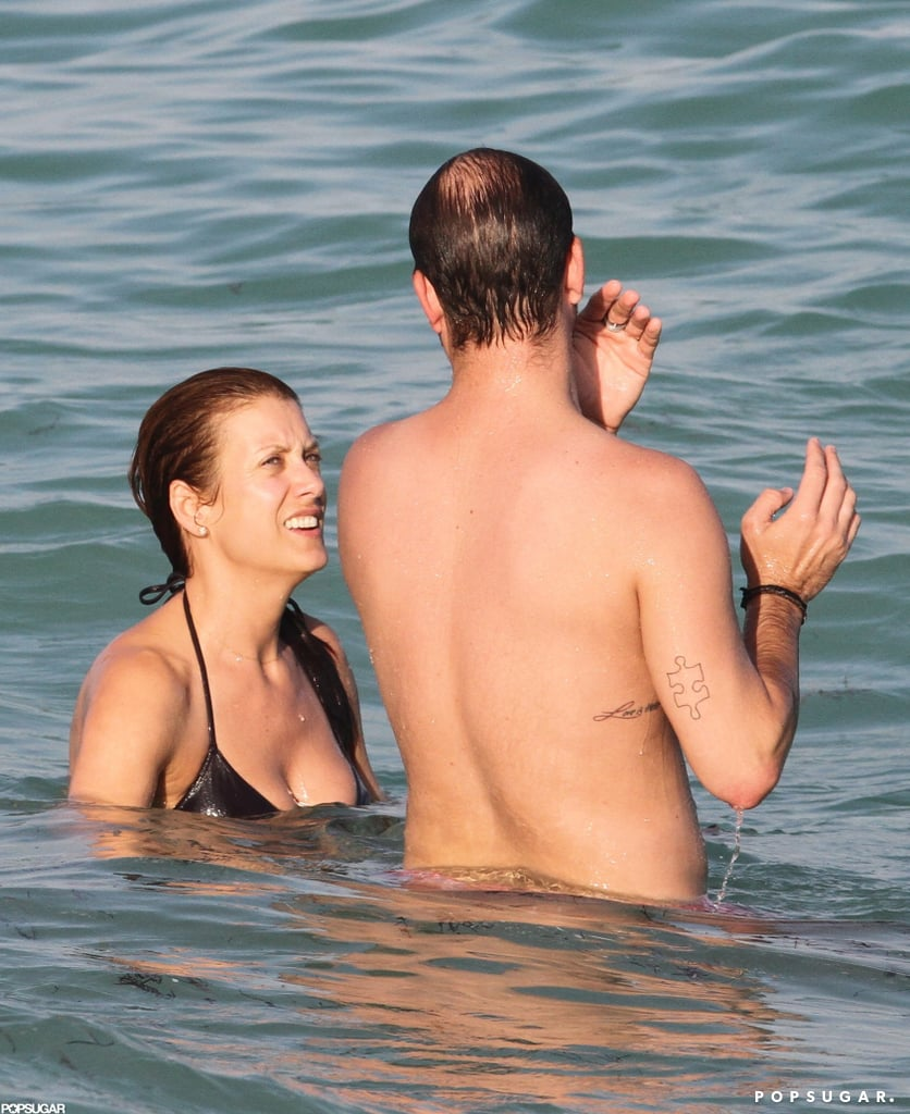 Kate Walsh splashed around with a friend in the ocean.